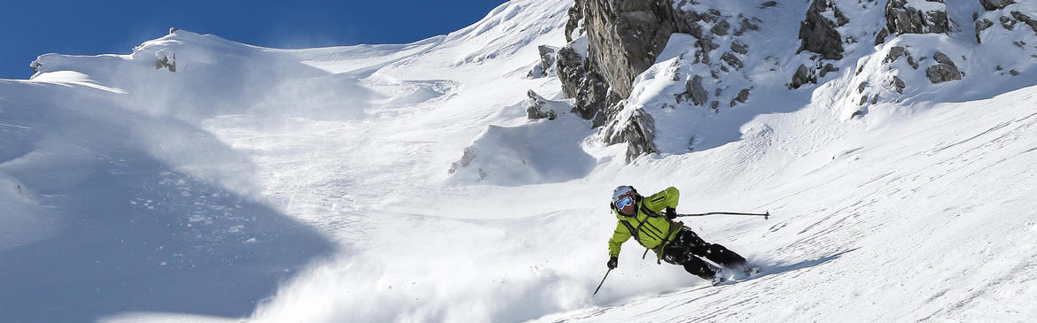 Man skiing off-piste in the mountains