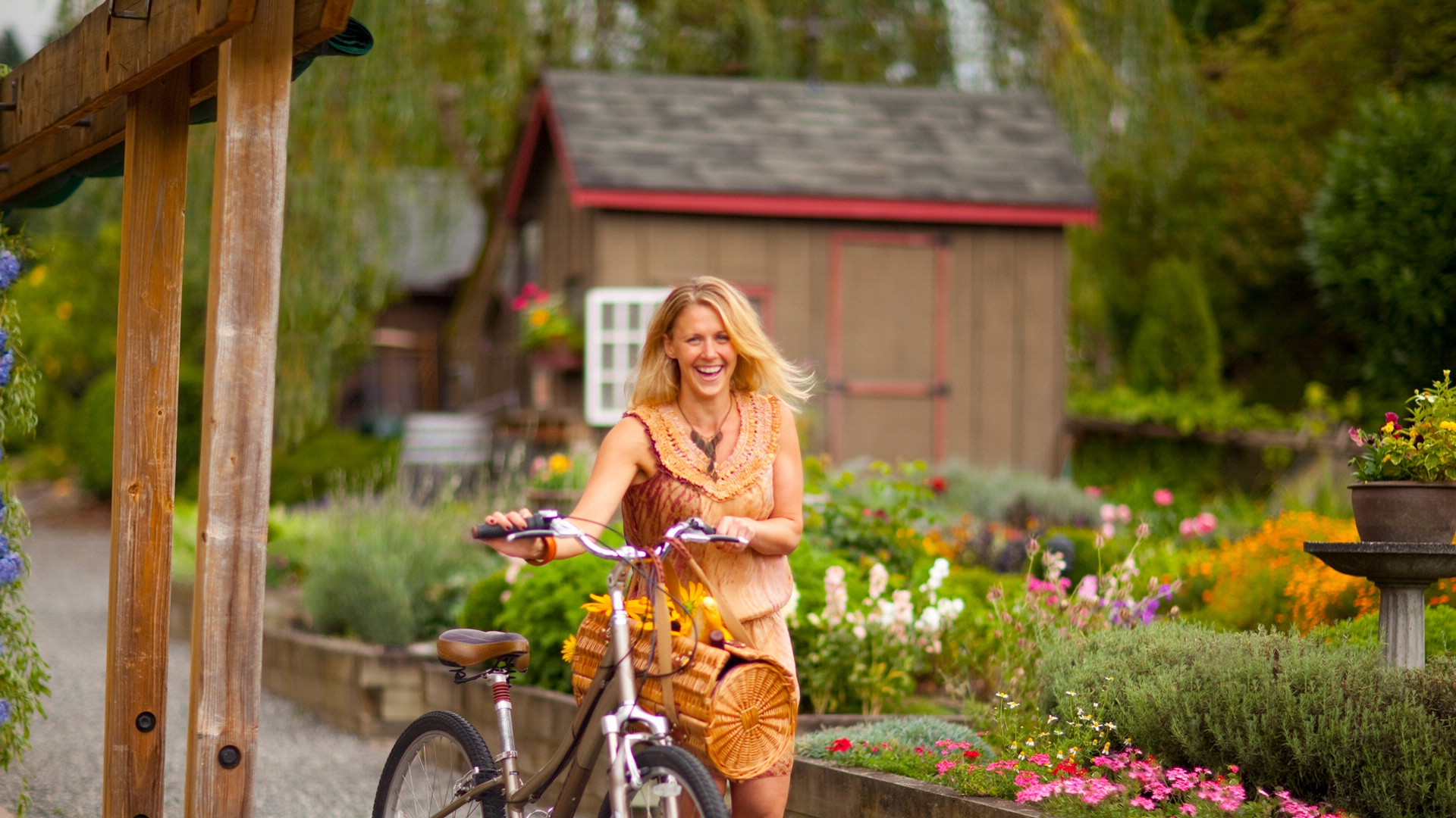 Woman smiling walking her bike