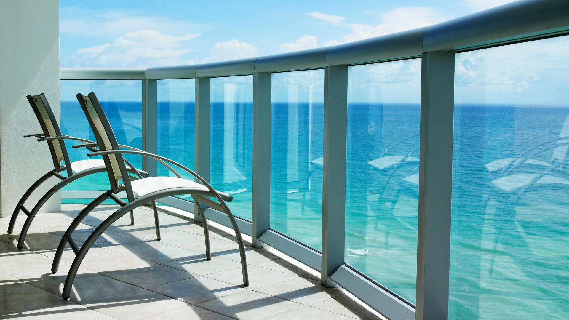 Balcony overlooking crystal blue ocean waters