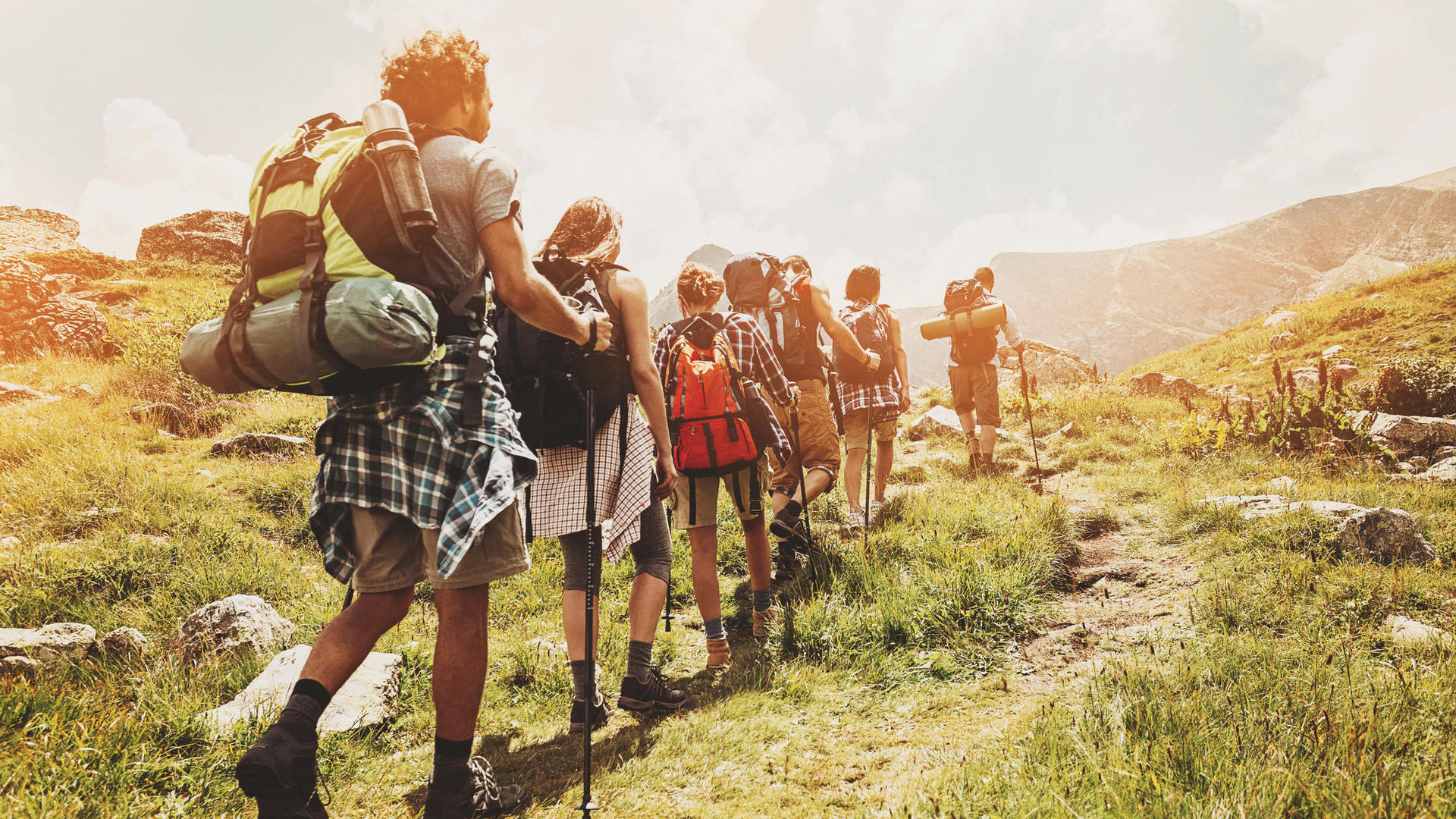 a group hiking with walking sticks