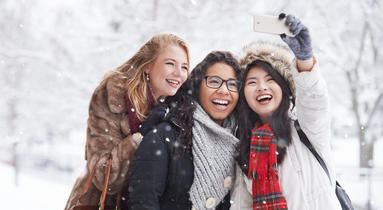 three women taking a selfie in the snow