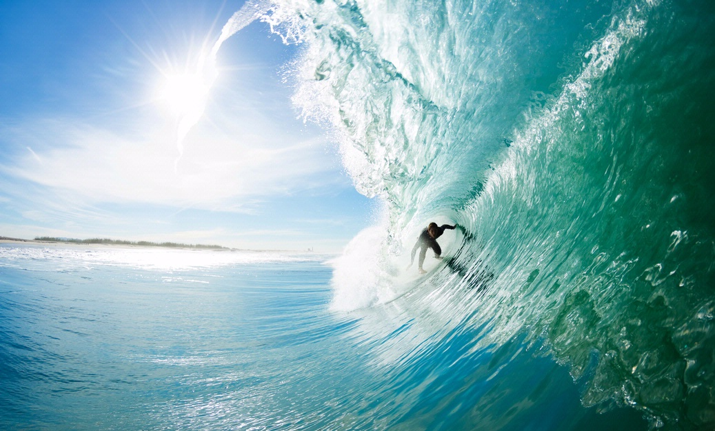 Man surfing on crystal blue water