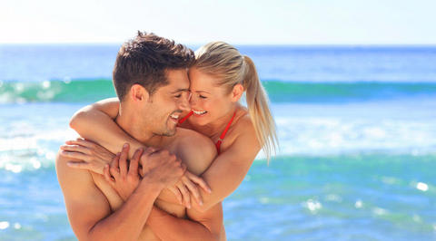 Boyfriend and girlfriend hugging on beach