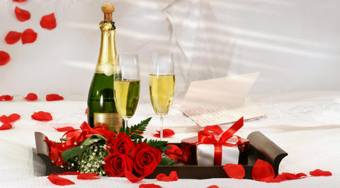 Bottle of champagne and romantic gifts