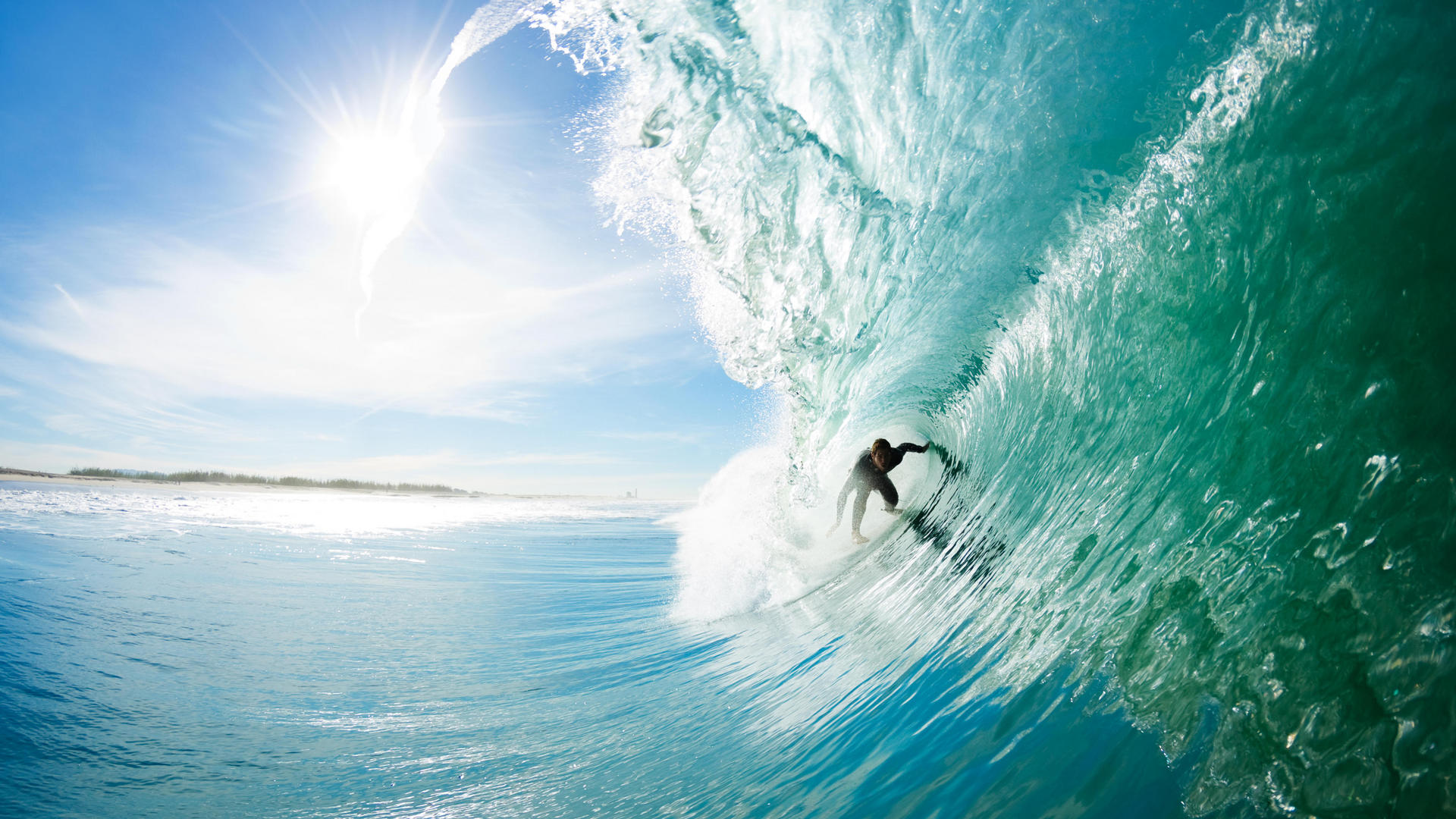 Man surfing in crystal blue water