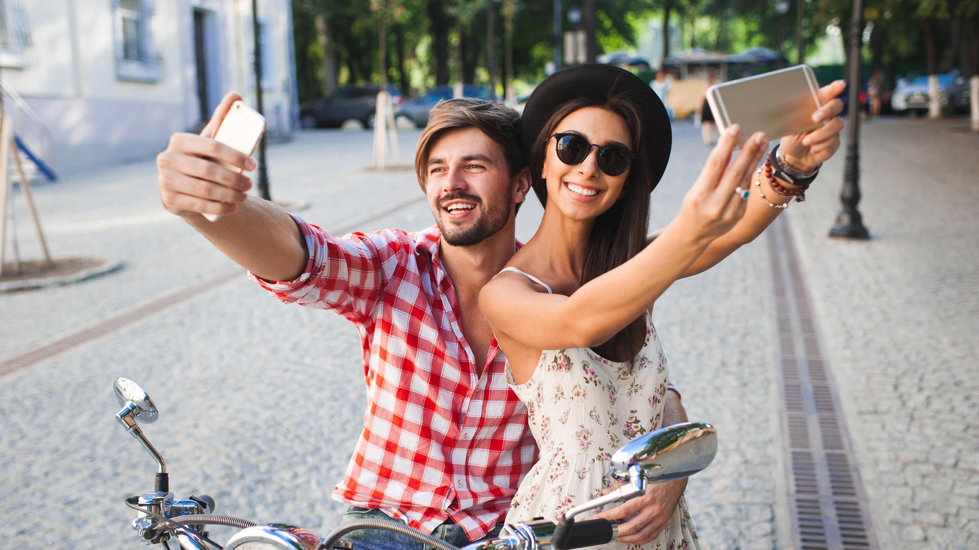 a couple taking a selfie on a bike